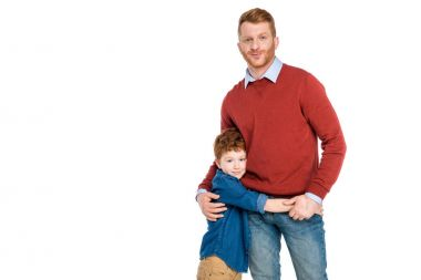 happy father and son hugging and smiling at camera isolated on white