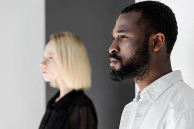 side view of african american boyfriend and blonde girlfriend looking away