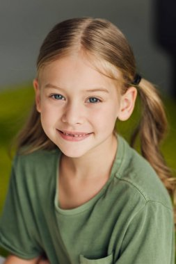 portrait of adorable little child smiling at camera