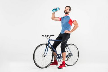 Sportsman with bicycle holding sport bottle, isolated on white stock vector