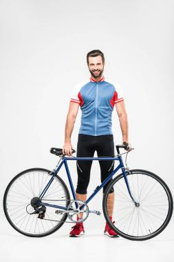 handsome cheerful cyclist in sportswear posing with bike, isolated on white