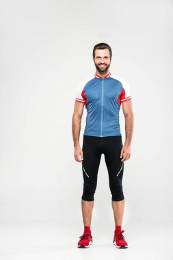 smiling cyclist standing in sportswear, isolated on white