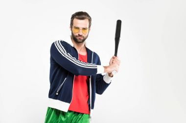 retro sportsman in sunglasses holding baseball bat, isolated on white
