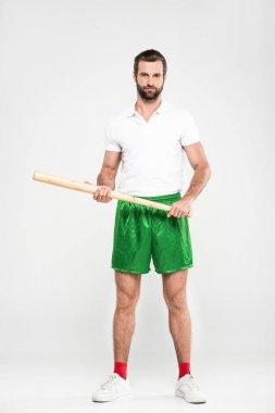 handsome sportsman holding baseball bat, isolated on grey