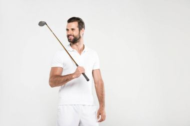 smiling golfer in white sportswear with golf club, isolated on grey