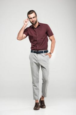 handsome man posing in casual closing and eyeglasses, isolated on grey