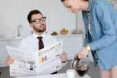 Photo businessman with economics newspaper looking at wife pouring coffee in cup for breakfast