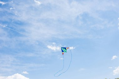 low angle view of flying kite with sky on background
