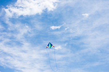 low angle view of kite with cloudy sky on background
