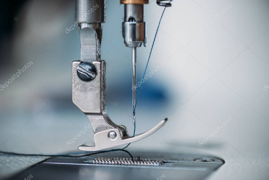 Close-up shot of needle and thread of sewing machine