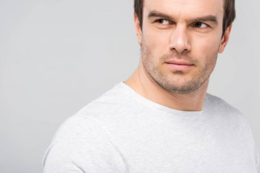 portrait of handsome man looking away, isolated on grey
