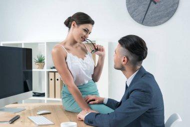 sexy secretary seducting boss at workplace