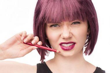 woman holding makeup pencil