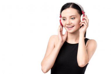 Smiling young woman listening music in headphones isolated on white stock vector