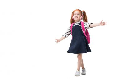 happy schoolgirl in headphones