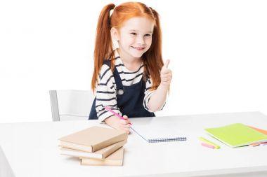schoolgirl drawing in notebook