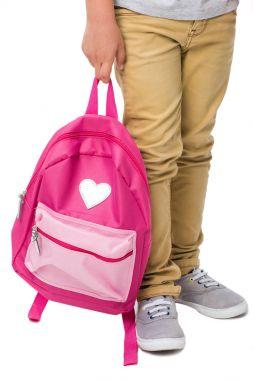 Boy holding backpack