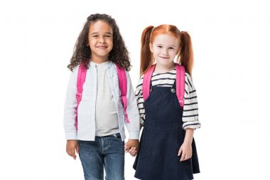 Multiethnic schoolgirls with backpacks