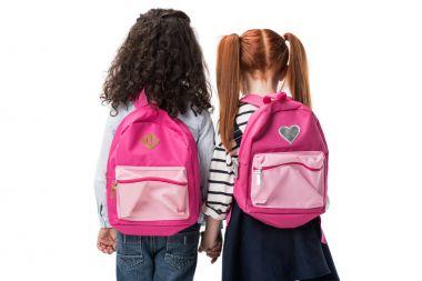 multiethnic schoolgirls with backpacks