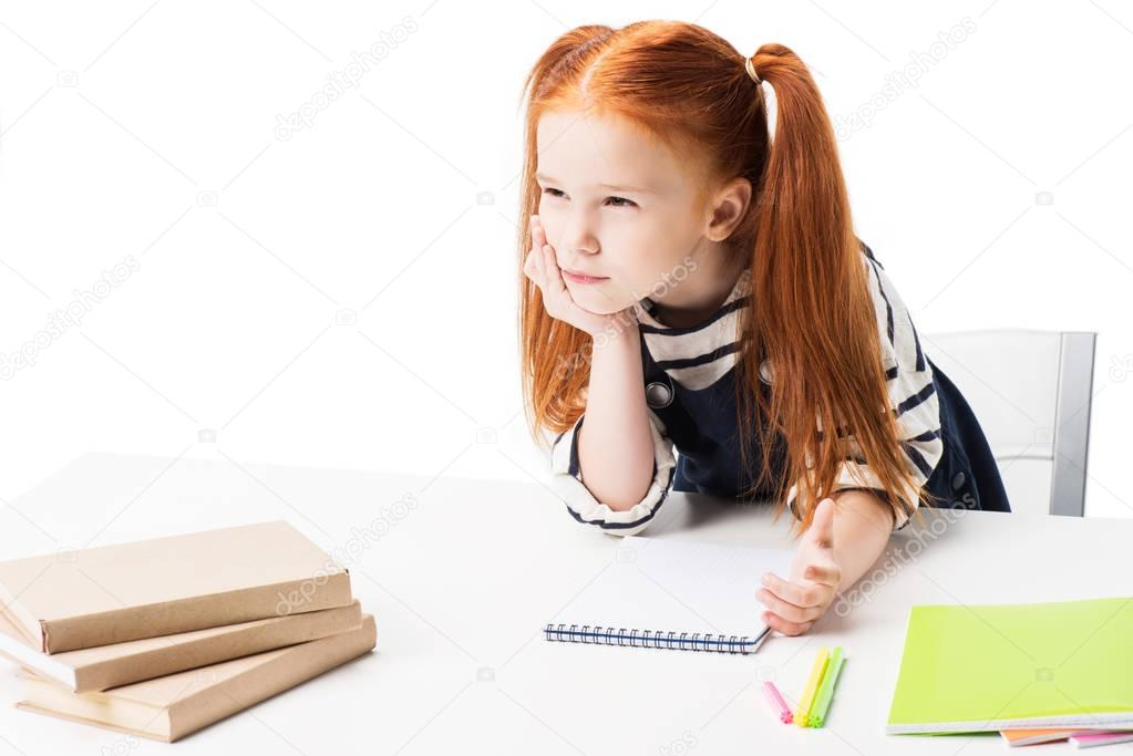 schoolgirl drawing in notebook
