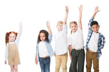 Multiethnic children raising hands