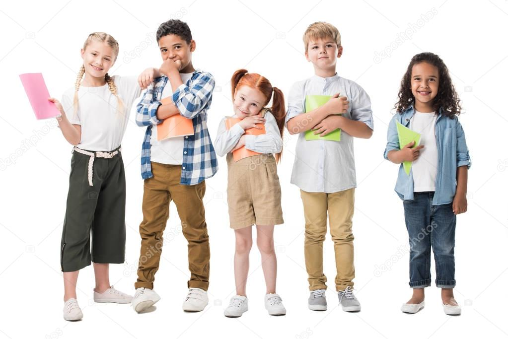 multiethnic children with textbooks