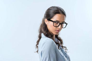 confident businesswoman in eyeglasses