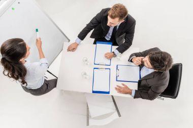 businesswoman explaining idea to colleagues