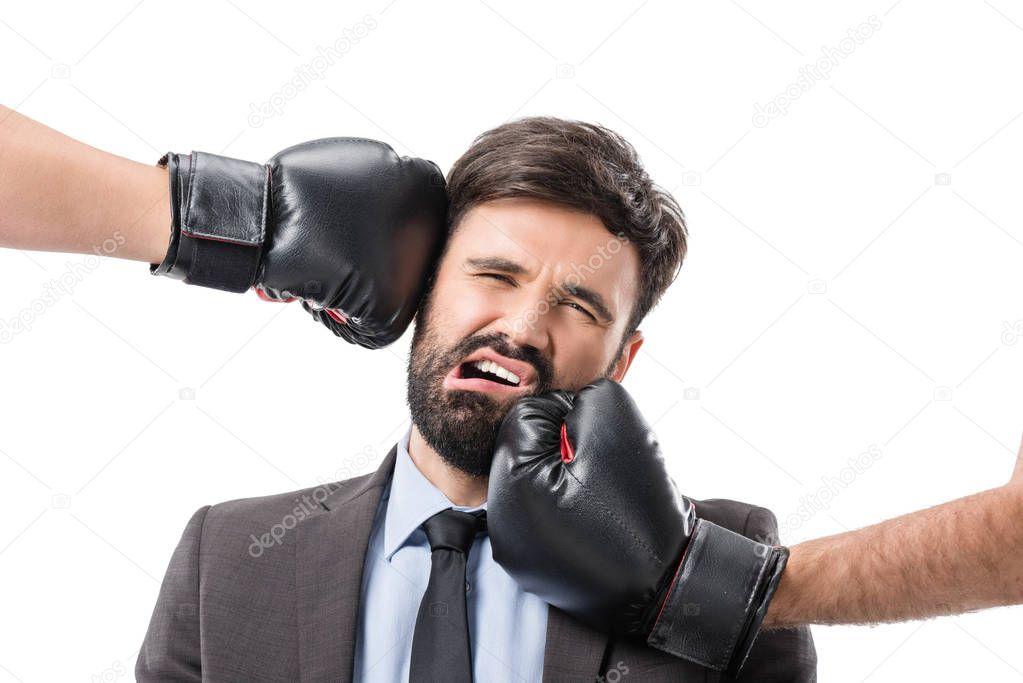 boxers punching businessman
