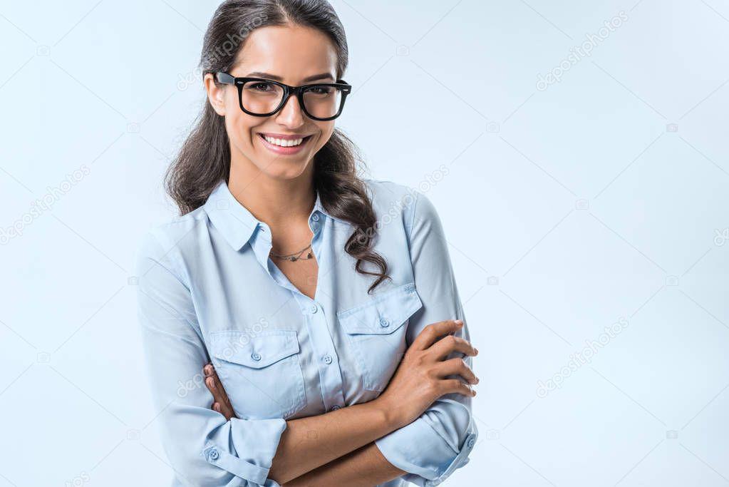smiling businesswoman in eyeglasses