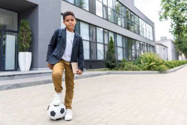 african american scoolboy with soccer ball