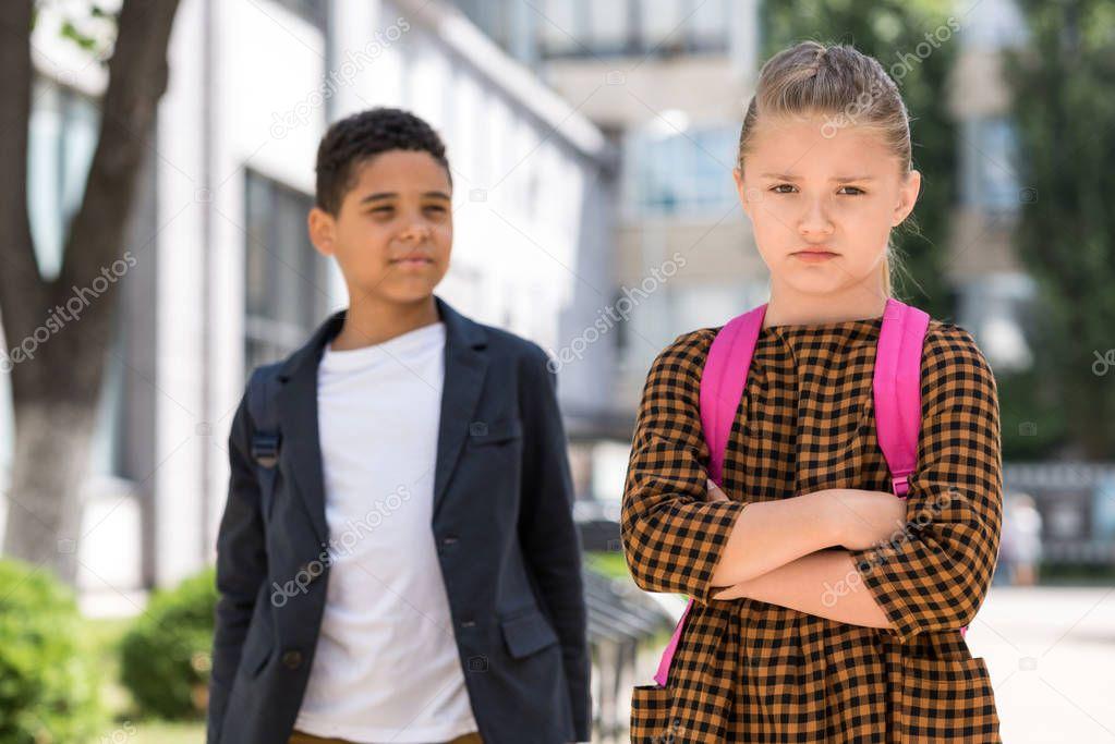 multiethnic schoolboy and schoolgirl
