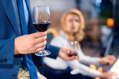 man bringing wine to woman