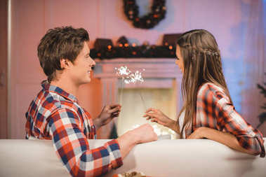 couple in love with sparklers