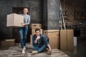 Photo couple moving at new apartment