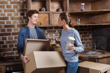 couple unpacking cardboard box