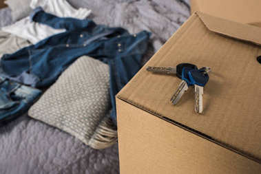 keys from apartment on cardboard box