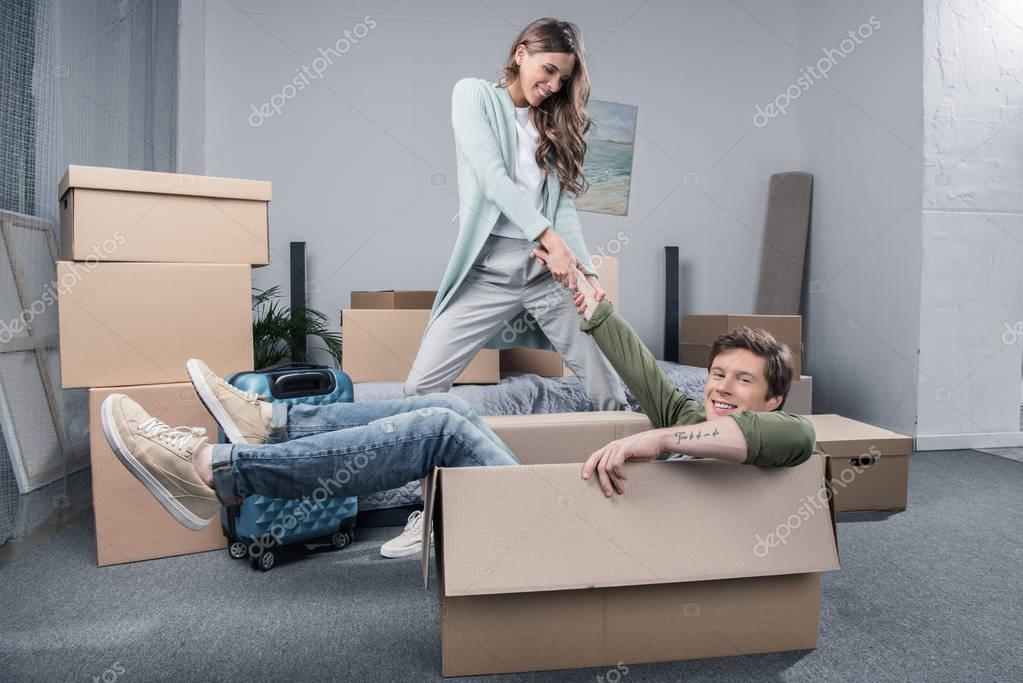 couple having fun at new home