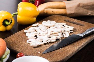 cut mushrooms on cutting board