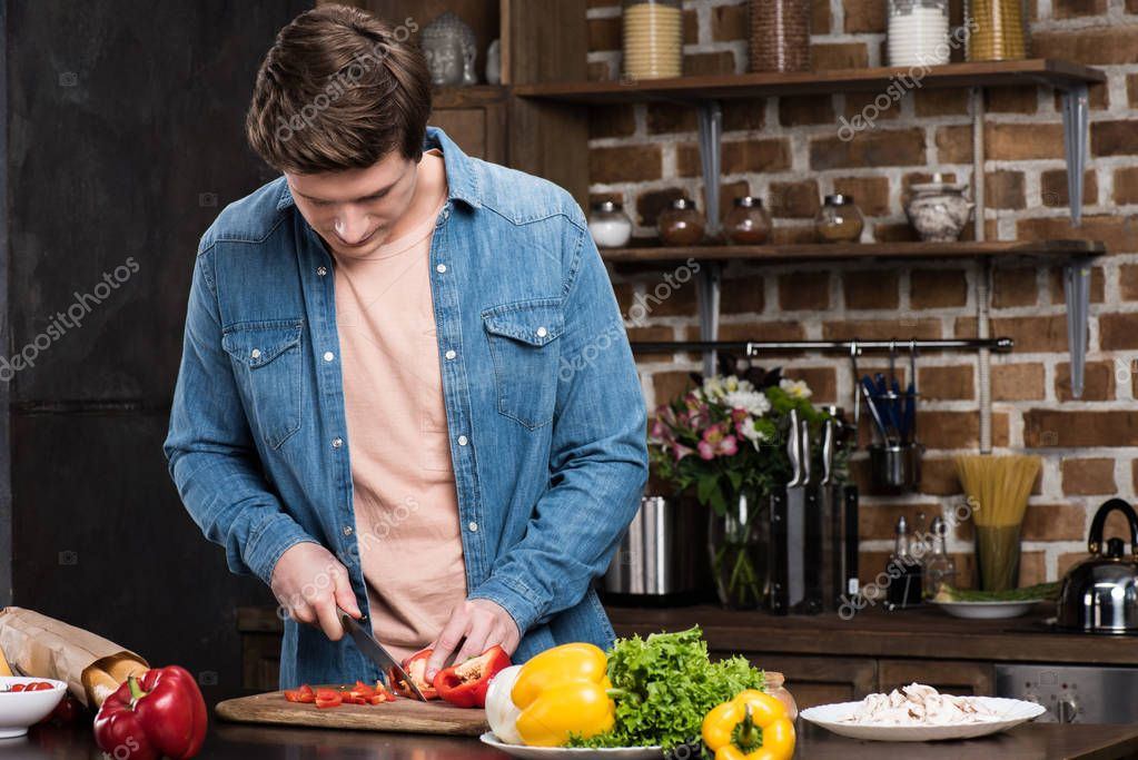 man cooking dinner