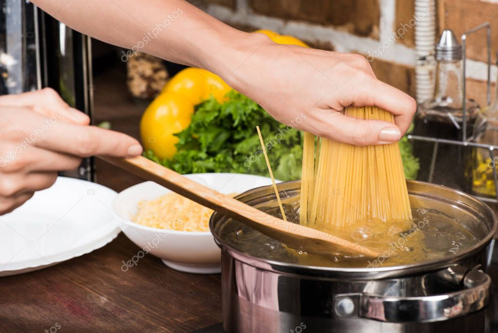 woman cooking pasta for dinner