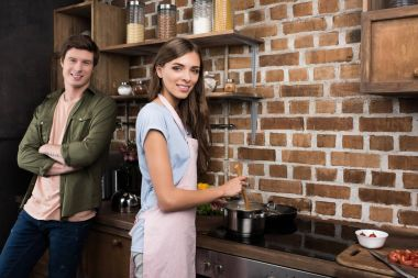 Woman cooking dinner for boyfriend