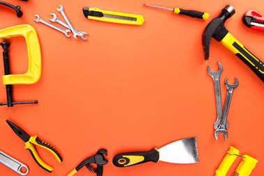Top view shot of composition with various reparement tools on orange surface stock vector