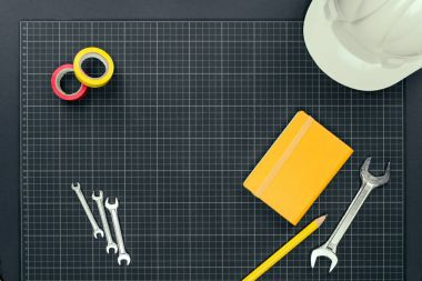 Notebook and tools on graph paper