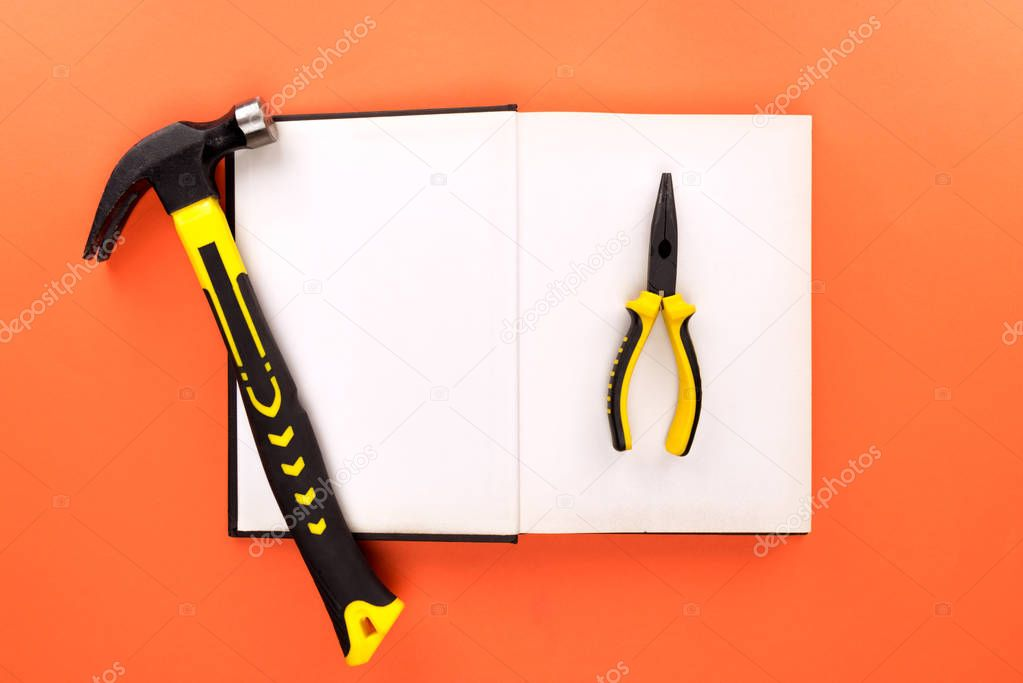 open book and tools