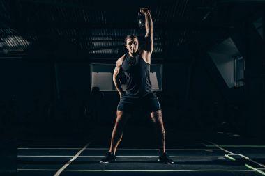 sportsman lifting kettlebell