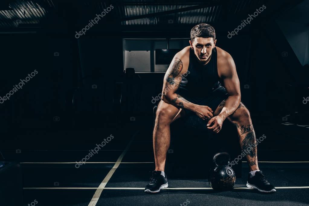 Athletic sportsman in gym