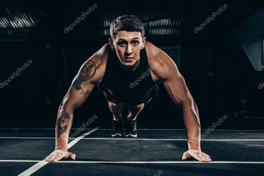 sportsman doing push ups