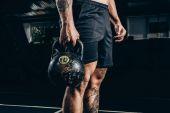 Photo sportsman holding kettlebell