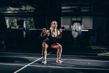 Sportswoman lifting barbell
